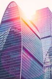 Abstract skyscrapers with sun glare toned in vintage style.  Royalty Free Stock Photo