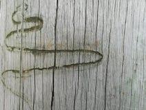 Abstract slang windend teken op houten achtergrond Stock Foto