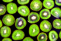 Abstract slice of kiwi on black. Stock Images