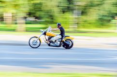 Abstract slow motion, biker riding yellow motorbike. Abstract Motion Blur, Biker Riding Motorbike, Driver Racing on the Big Yellow Bike, Side View, Blur Movement Stock Images