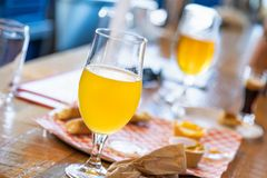 Abstract of Small Glass of Micro Brew Beers On Bar. Abstract of Small Glass of Micro Brew Beers and Food On Bar royalty free stock photos