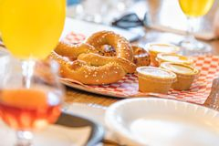 Abstract of Small Glass of Micro Brew Beers and Warm Pretzels On. A Bar royalty free stock images