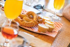 Abstract of Small Glass of Micro Brew Beers and Warm Pretzels On. Bar stock photo