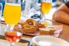 Abstract of Small Glass of Micro Brew Beers and Warm Pretzels. On Bar stock images