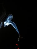 Abstract smoke. Smoke from an incense stick against a black background Stock Photos