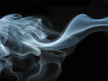 Abstract smoke. Blue and white smoke on a black  background Royalty Free Stock Photo