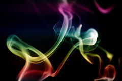 Abstract smoke art. View of some abstract form of colored smoke art isolated on a black background Stock Images