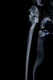 Abstract of smoke dance on a black background. Stock Image