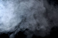 Abstract smoke hookah on a black background. Stock Images