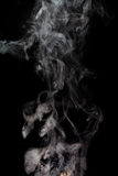 Abstract Smoke. From rebuildable drip atomizer (RDA) on a black color background Royalty Free Stock Photos