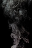 Abstract Smoke. From rebuildable drip atomizer (RDA) on a black color background Stock Photography