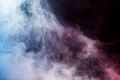 Abstract smoke shapes on black stock photography