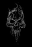 Abstract smoke skull. Smoke makes the shape of spooky skull Royalty Free Stock Photos
