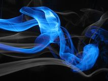 Abstract smoke waves. Blue and white smoke on a black  background Royalty Free Stock Images