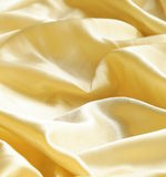 Abstract smooth  gold silk background Stock Photography