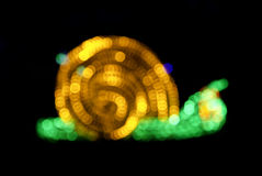 Abstract snail shape lights bokeh Royalty Free Stock Photo