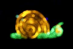Abstract snail shape lights bokeh Royalty Free Stock Photo