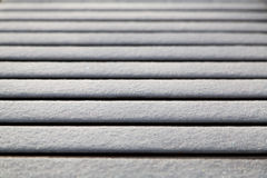 Abstract of snow on bench Stock Photo