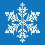 Abstract snowflake. On blue background Stock Images