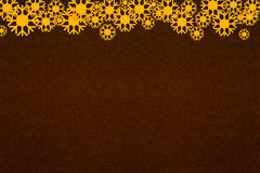 Abstract snowflake on dark brown paper texture Stock Image
