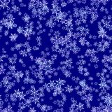 Abstract snowflake pattern on dark blue background. Winter texture. Seamless illustration. Stock Photography