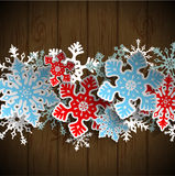 Abstract snowflakes on dark wood, winter concept Stock Image
