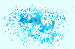 Abstract snowflakes and splashes of watercolor on blue background Stock Image