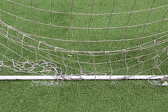 Soccer goal with net details. Abstract soccer goal net closeup with soccer field background. Selective focus used Stock Photography