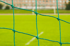 Abstract soccer goal net pattern. On green live, real grass close-up Royalty Free Stock Images