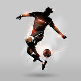 Abstract soccer jumping touch ball. Abstract soccer player jumping touch a soccerball in the air Royalty Free Stock Photo