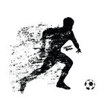 Abstract soccer player runs with ball Royalty Free Stock Images