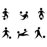 Abstract soccer players icons. Black silhouettes Stock Photography