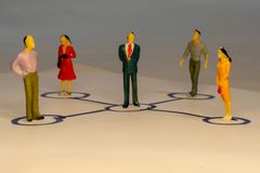 Abstract social network scheme which contains miniature business people connected to each other. Networking concept.  stock photos
