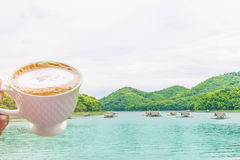 Abstract soft blurred and soft focus a cup of coffee,the raft,the swamp,the mountain  beautiful sky and cloud at Huai Krathing, Lo Royalty Free Stock Photo