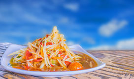 Abstract soft blurred and soft focus of spicy papaya salad with blurred the beautiful sky cloud  background. Thai local food. Abstract soft blurred and soft Royalty Free Stock Image
