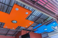 Abstract soft focus colorful of the roof, ceiling structure, building, with the lamps and fan.The public properties in Thailand. Royalty Free Stock Photo