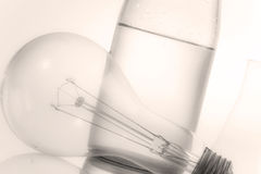 Abstract soft focus still life with bottle and electric lamp Royalty Free Stock Photo