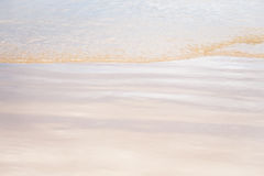 Abstract soft sea wave on the beach at twilight time Stock Image