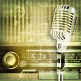 Abstract sound grunge background with microphone and retro radio Stock Images