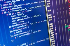 Abstract source code background. Server logs analysis. Writing programming code on laptop. Young business crew working with startup stock image
