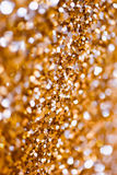Abstract Spangles golden holidays  lights on background Stock Photo