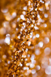 Abstract Spangles golden holidays  lights on background Stock Images