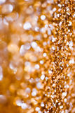 Abstract Spangles golden holidays  lights on background Royalty Free Stock Photos