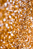 Abstract Spangles golden holidays  lights on background Royalty Free Stock Image