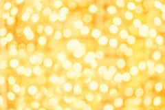 Abstract Sparkling Golden lights with bokeh effect. Splashes of Stock Images