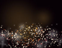 Abstract Sparkling Stars Golden Holiday Background bokeh effect. Royalty Free Stock Images