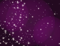 Abstract Sparkling Stars Lilac Holiday Background bokeh effect. Royalty Free Stock Photography