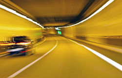 Abstract speed motion. In highway tunnel, background Royalty Free Stock Photo