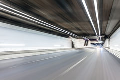 Abstract speed motion in highway road tunnel, blurred motion tow Royalty Free Stock Photo