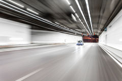 Abstract speed motion in highway road tunnel, blurred motion tow Stock Photos